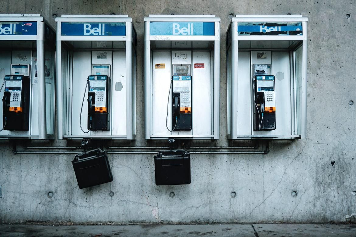 photo of four old pay phones in Canada