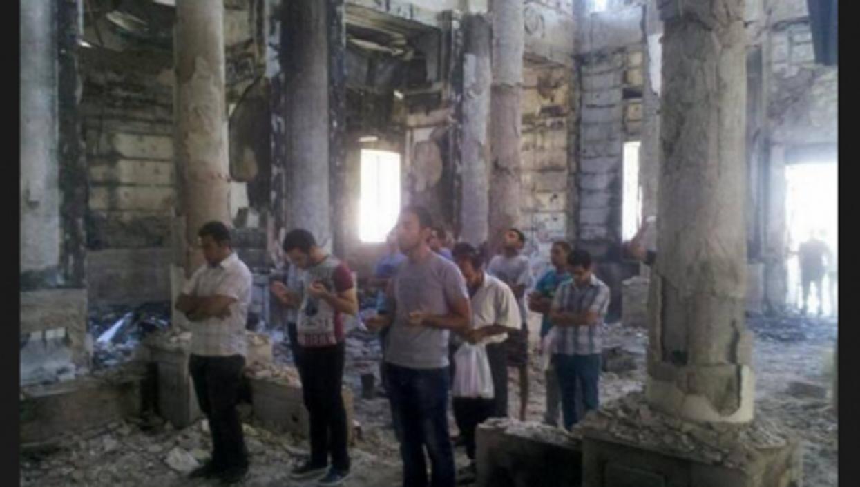 Faithful pray in burned Egyptian Coptic Church