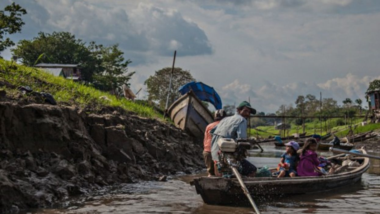 Family on the river in Leticia, Amazonas