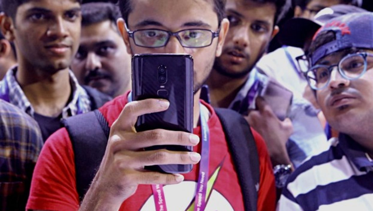 Fans check out Oneplus 6 smartphone at an India Launch event