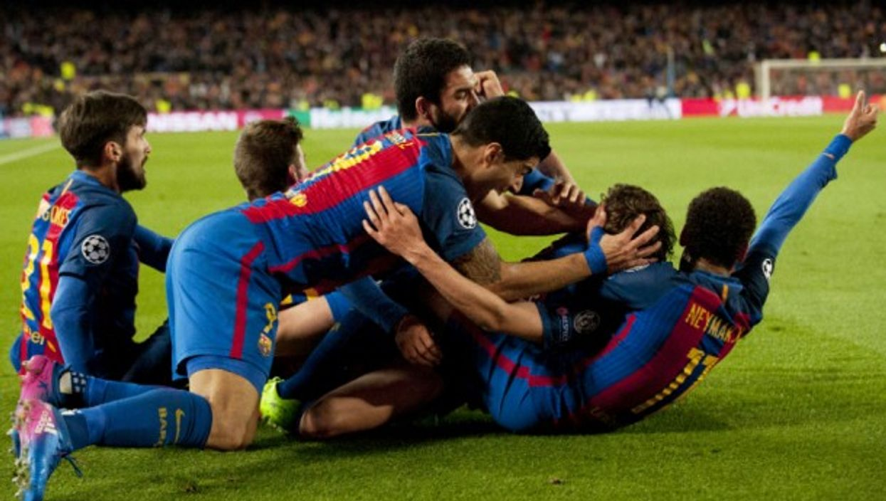 FC Barca players celebrate at Camp Nou on March 8
