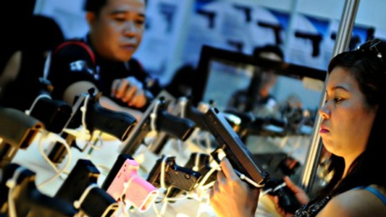 Filipinos at a gun show to promote responsible ownership in Mandaluyong