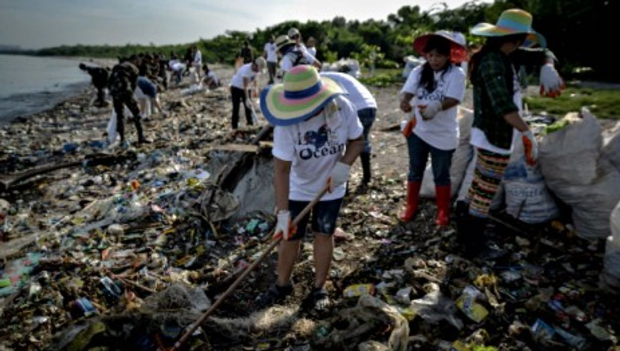 Filipinos clean up a beach on World Oceans Day in Paranaque