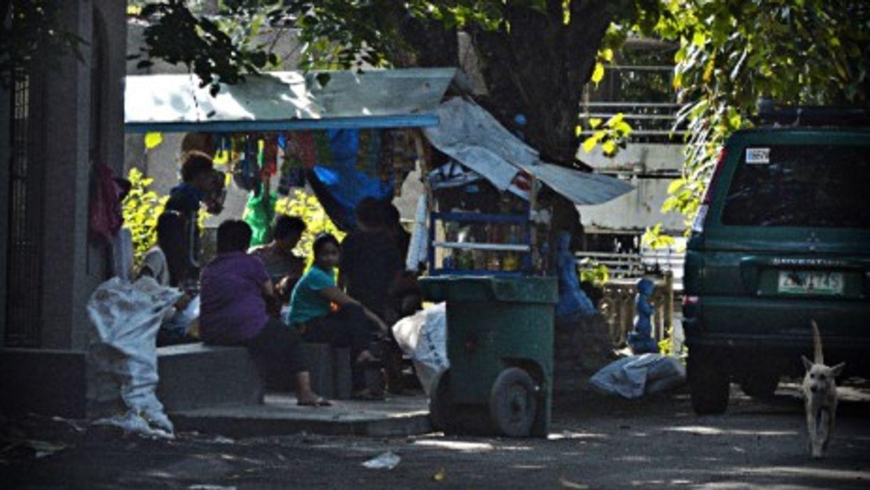 Filipinos living in Manila's South Makati Cemetery