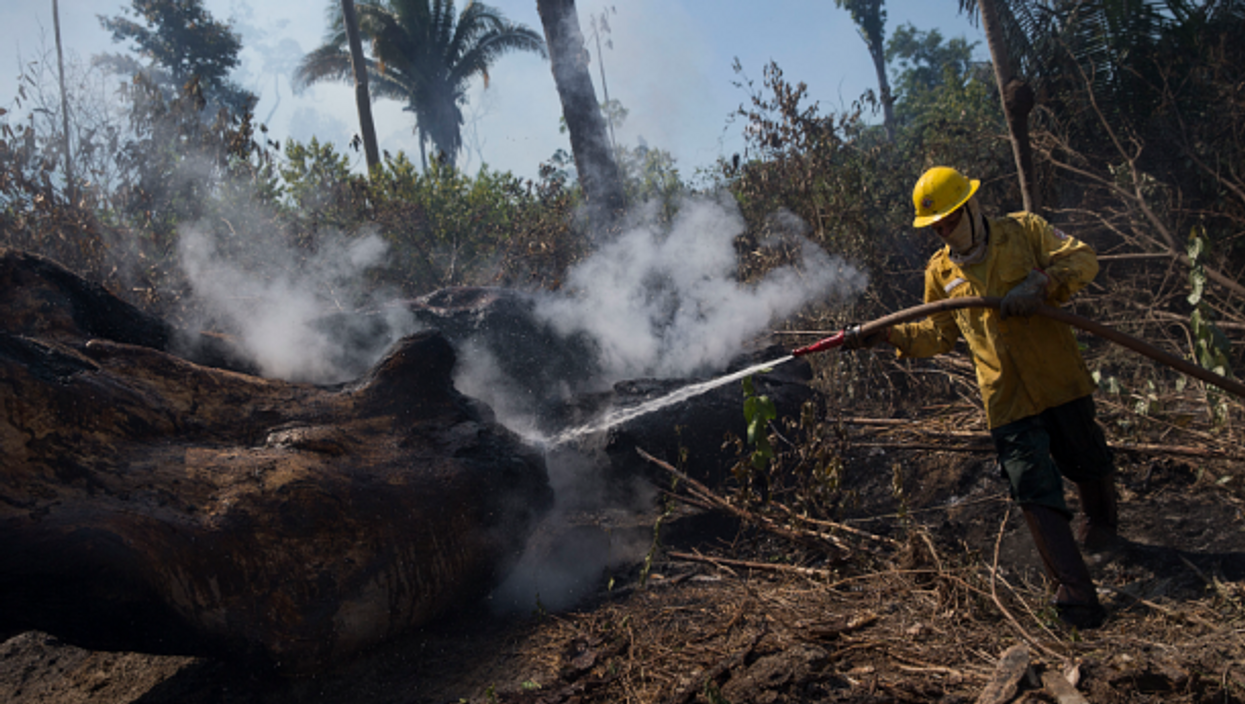 Fire fighter in Novo Progresso, Brazil, on Aug. 15