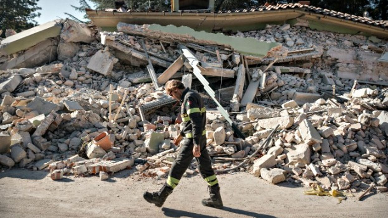 Firefighter in Amatrice on Aug. 28