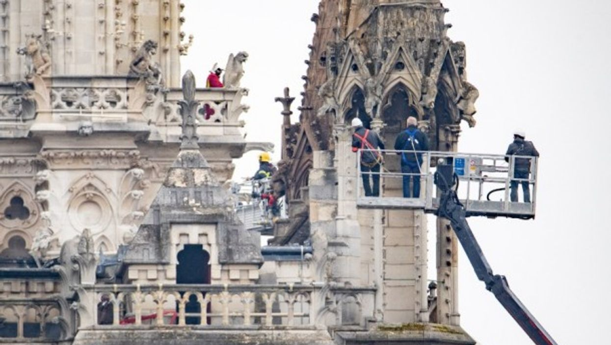 Firefighters assessing the damage at the Notre Dame cathedral
