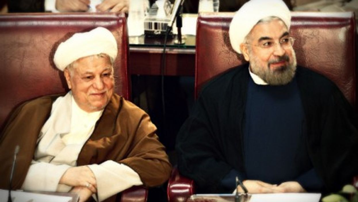Former and current Iranian presidents Rafsanjani Rouhani in Tehran last year