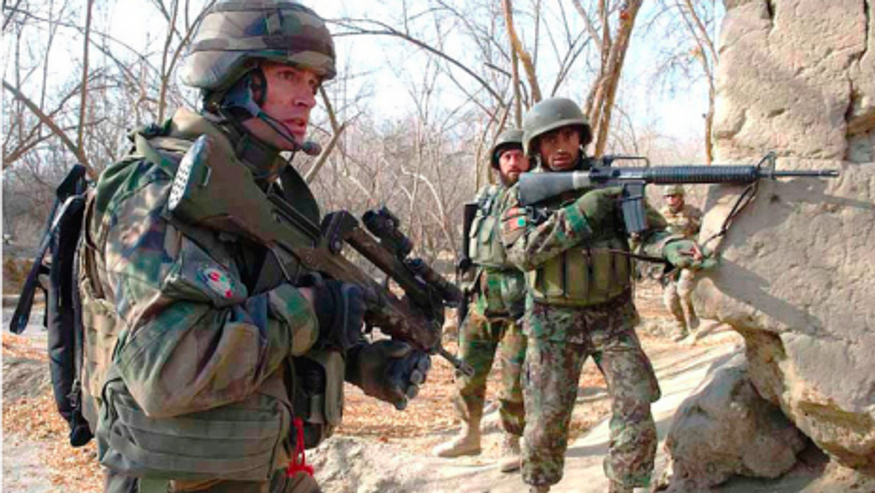 French (left) and Afghan soldiers together on a mission last year in Kapisa Province (Isaf)