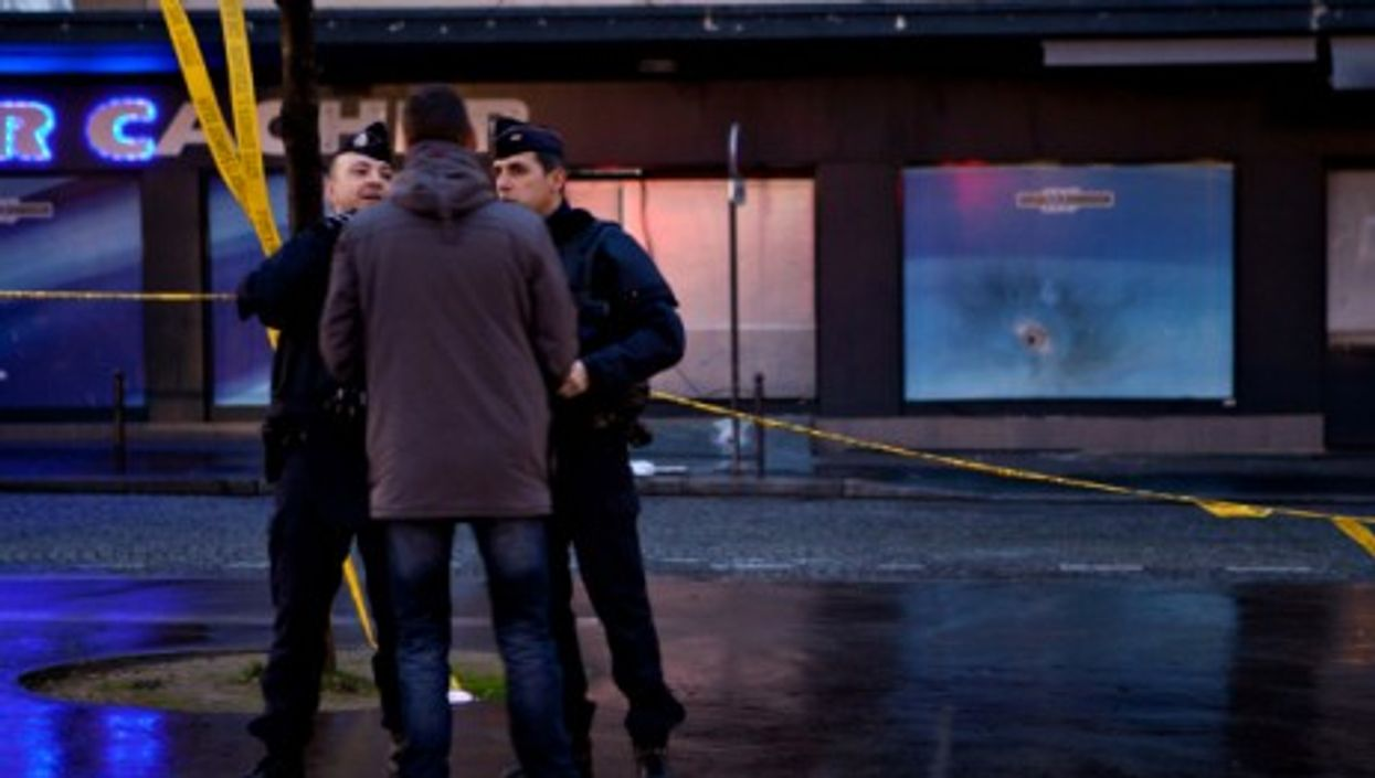 French policemen in front of the Paris supermarket attacked on Jan. 9