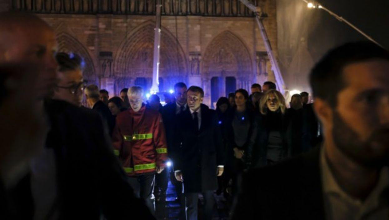 French President Emmanuel Macron promised to rebuild Notre Dame on Monday