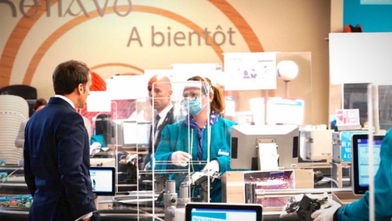 French President Emmanuel Macron visiting a supermarket in western France on April 22