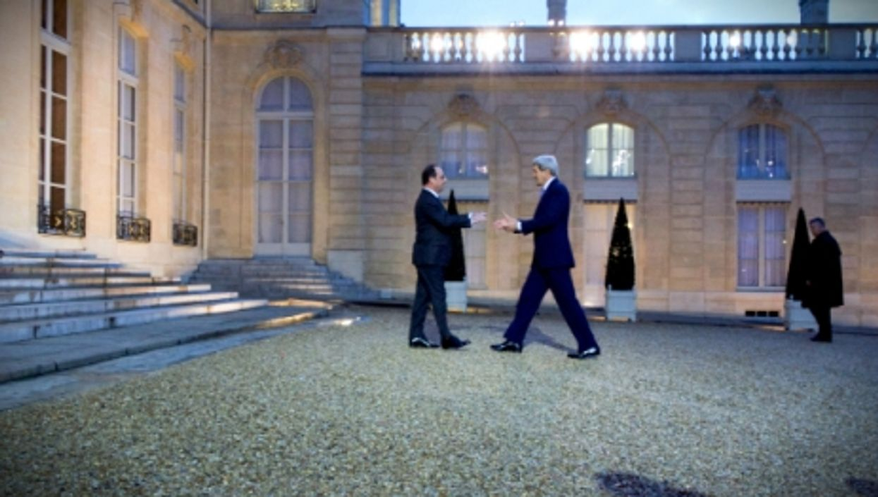 French President François Hollande welcomes Secretary of State John Kerry to the Élysée Palace in Paris, on Jan. 16, 2015.
