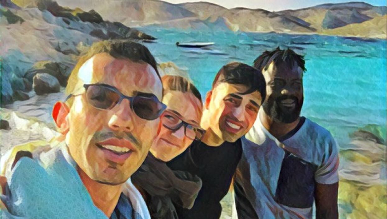 From left to right: the author, a volunteer and two refugees in Chios, Greece