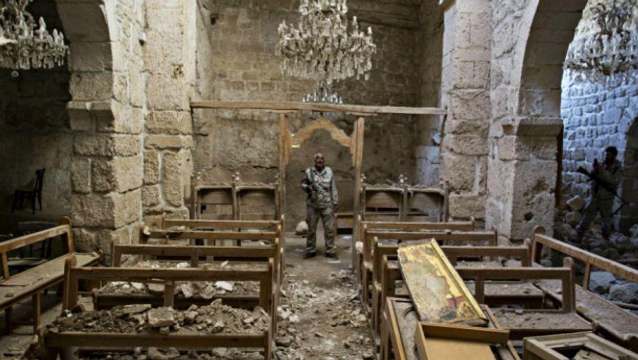 FSA leader inside a church in Maloula, Syria