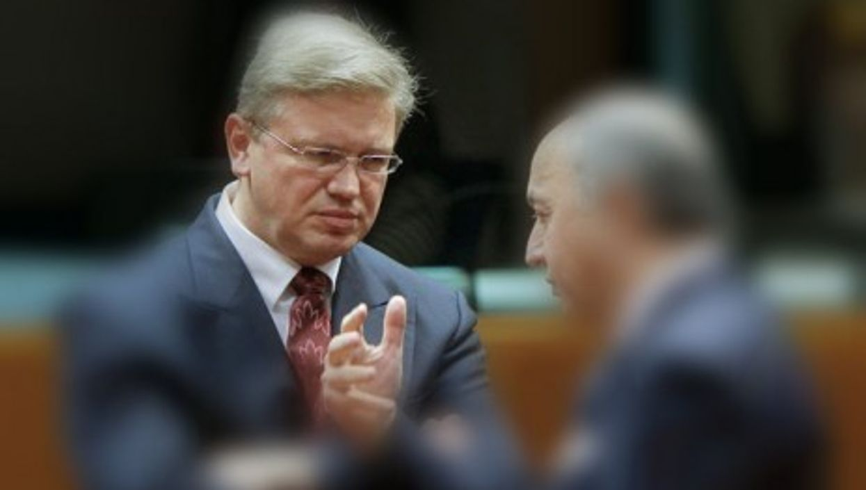 Fule (left) speaking with French Foreign Minister Laurent Fabius