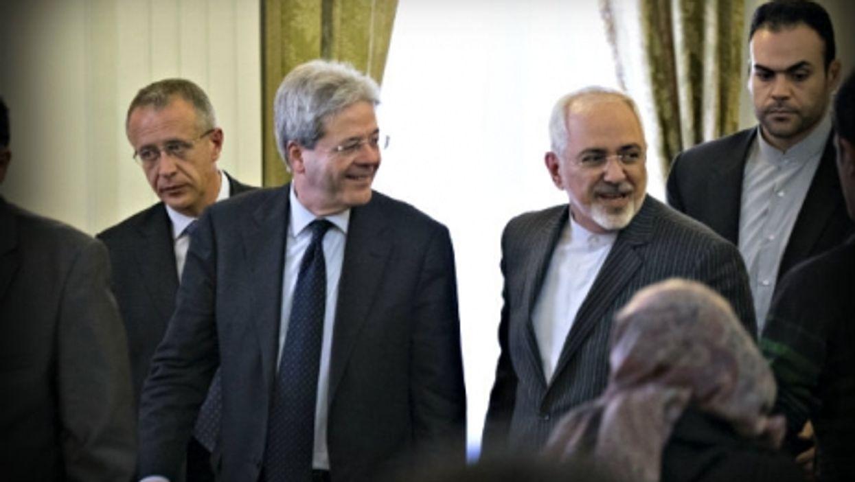 Gentiloni (left) and Zarif in Tehran