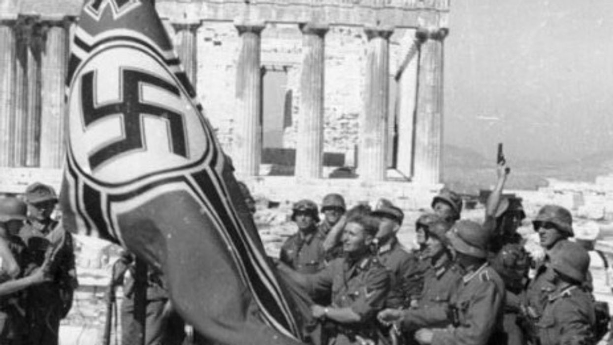 German soldiers raise their flag over the Acropolis in Athens, Greece (1941)