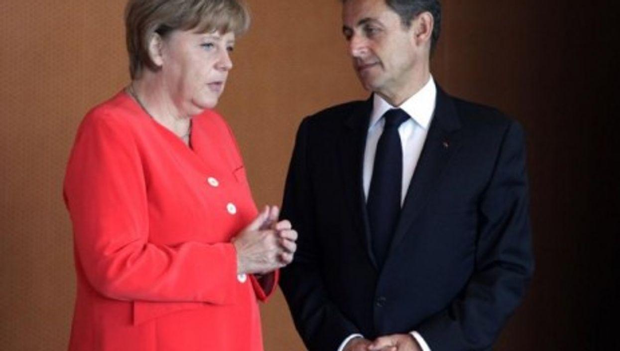 Germany's Angela Merkel and Nicolas Sarkozy of France