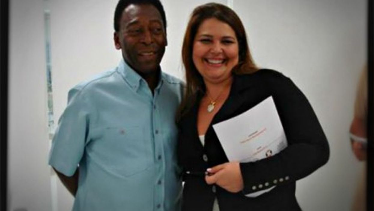 Gislaine Nunes with Brazilian soccer legend Pele