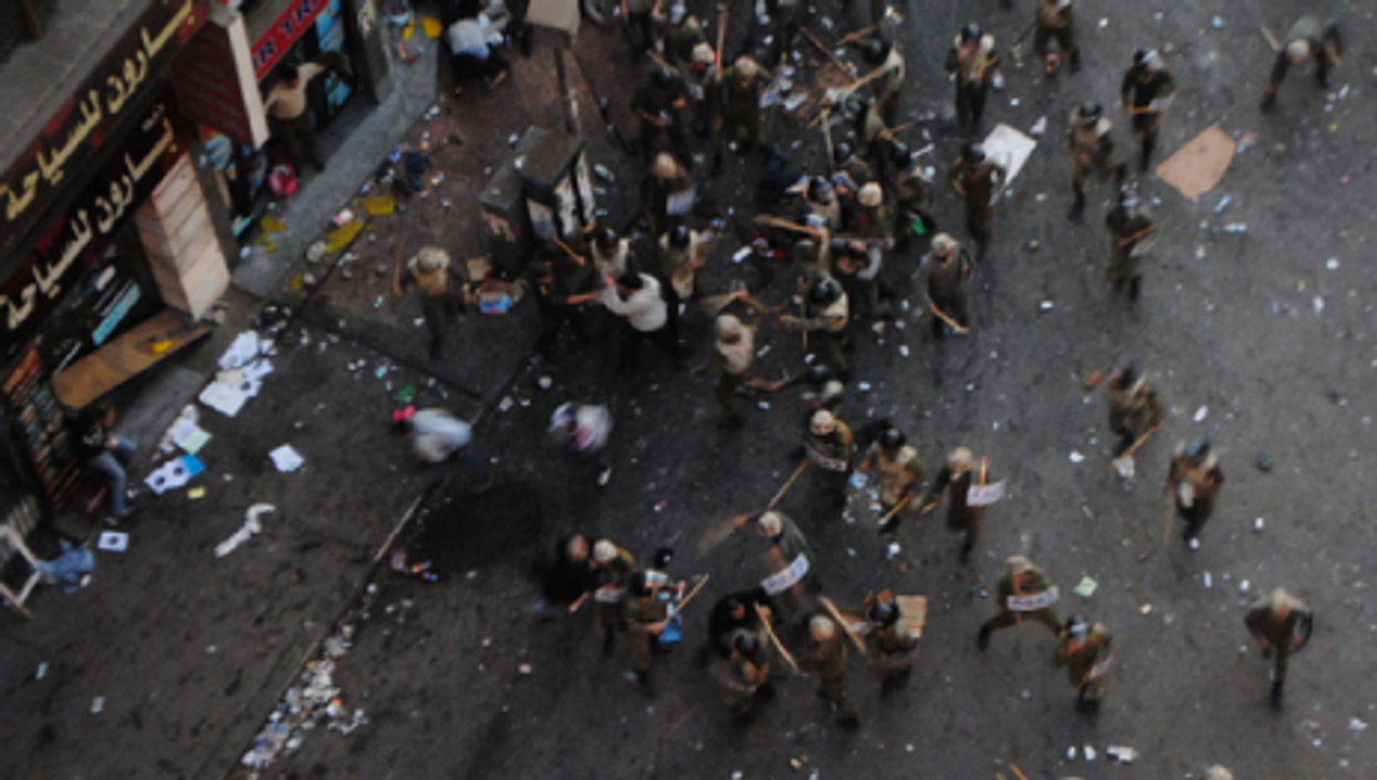 Government troops on Sunday beat demonstrators in Tahrir Square (lilianwagdy)