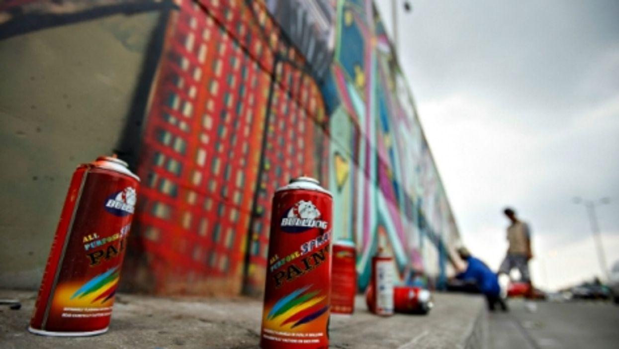 Graffiti artists at work in Bogota