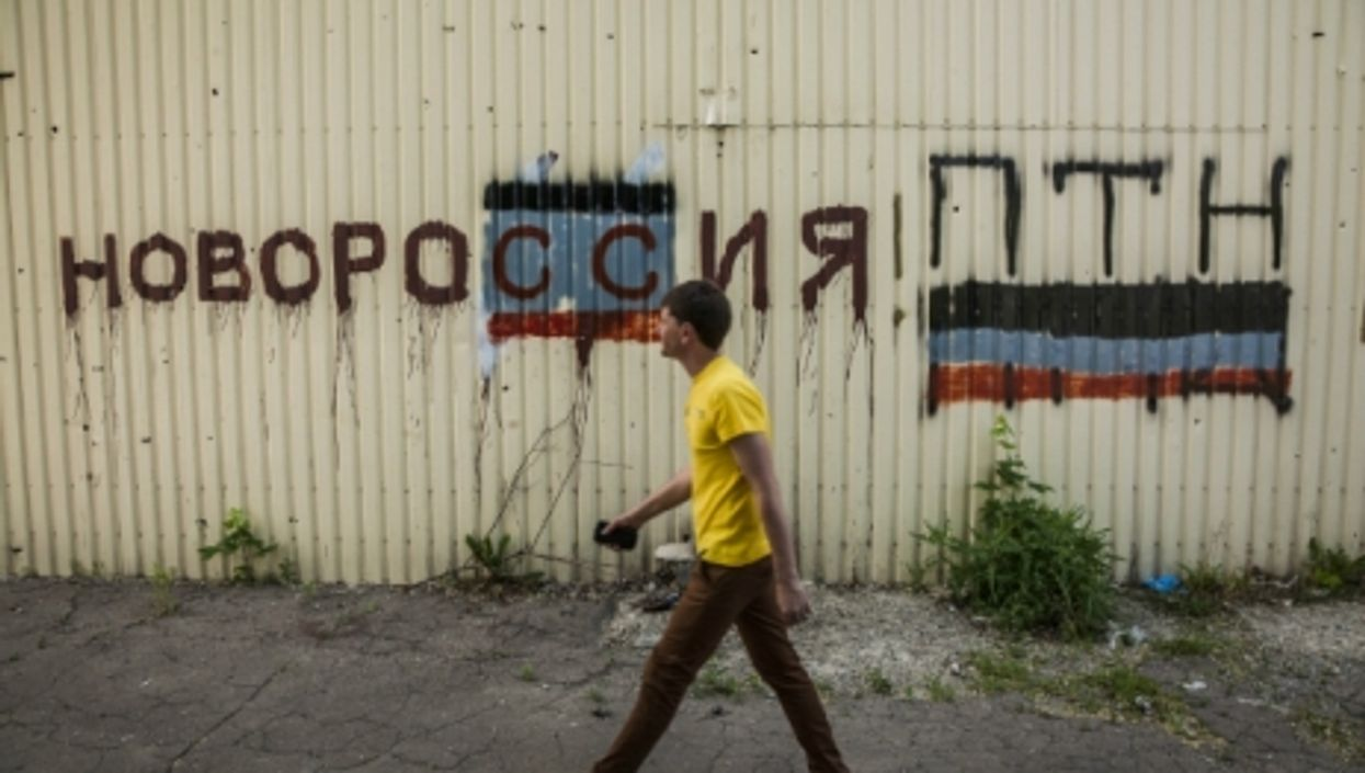 Graffiti over a wall in Donetsk, eastern Ukraine, says ''Novorossiya! Putin''