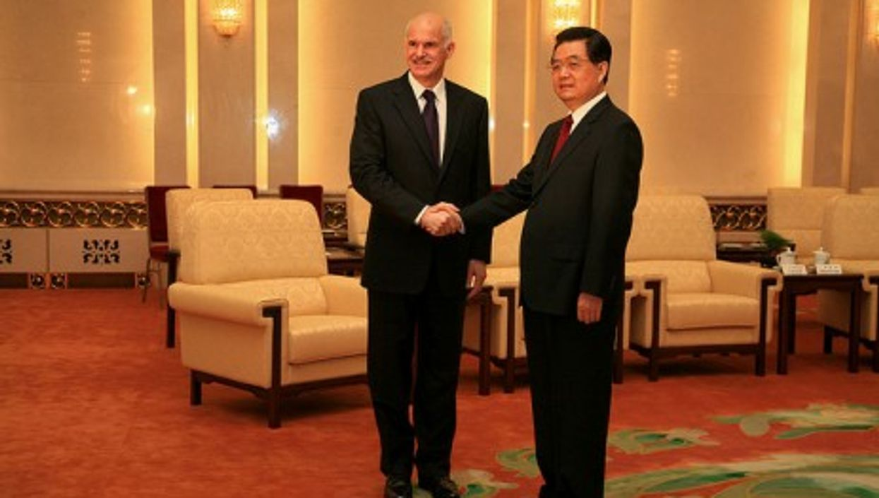 Greek Prime Minister George Papandreou shaking hands with Chinese President Hu Jintao