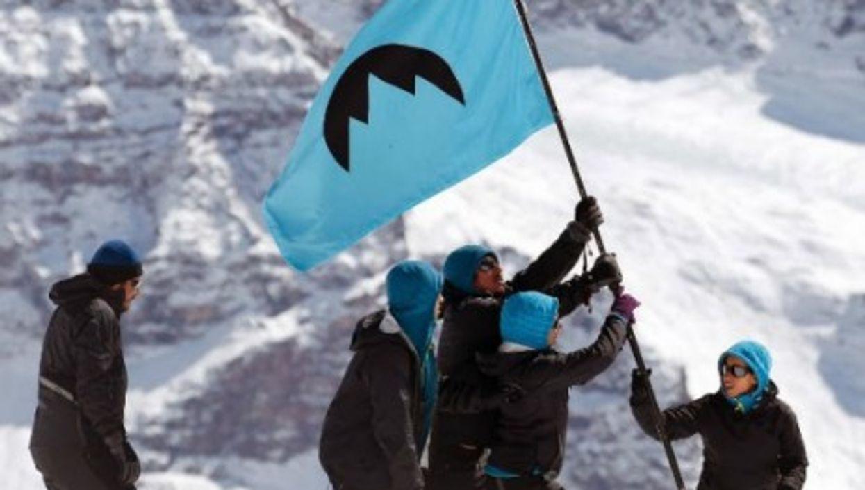 Greenpeace activists planting the Glacier Republic flag