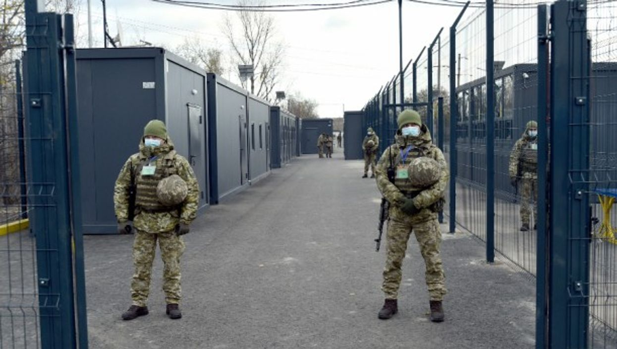 Guards on the premises of an entry exit checkpoint in Donbass
