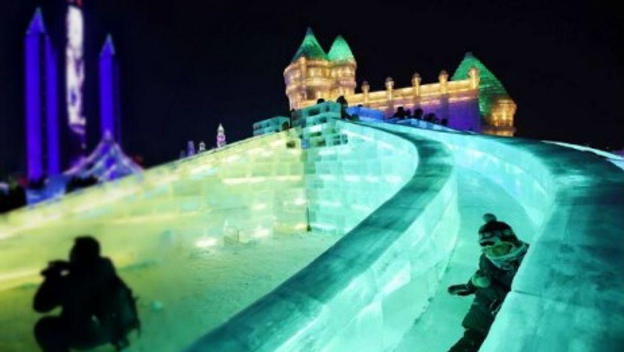 Having fun on ice slides Monday at Harbin's Ice and Snow World in northeastern China.