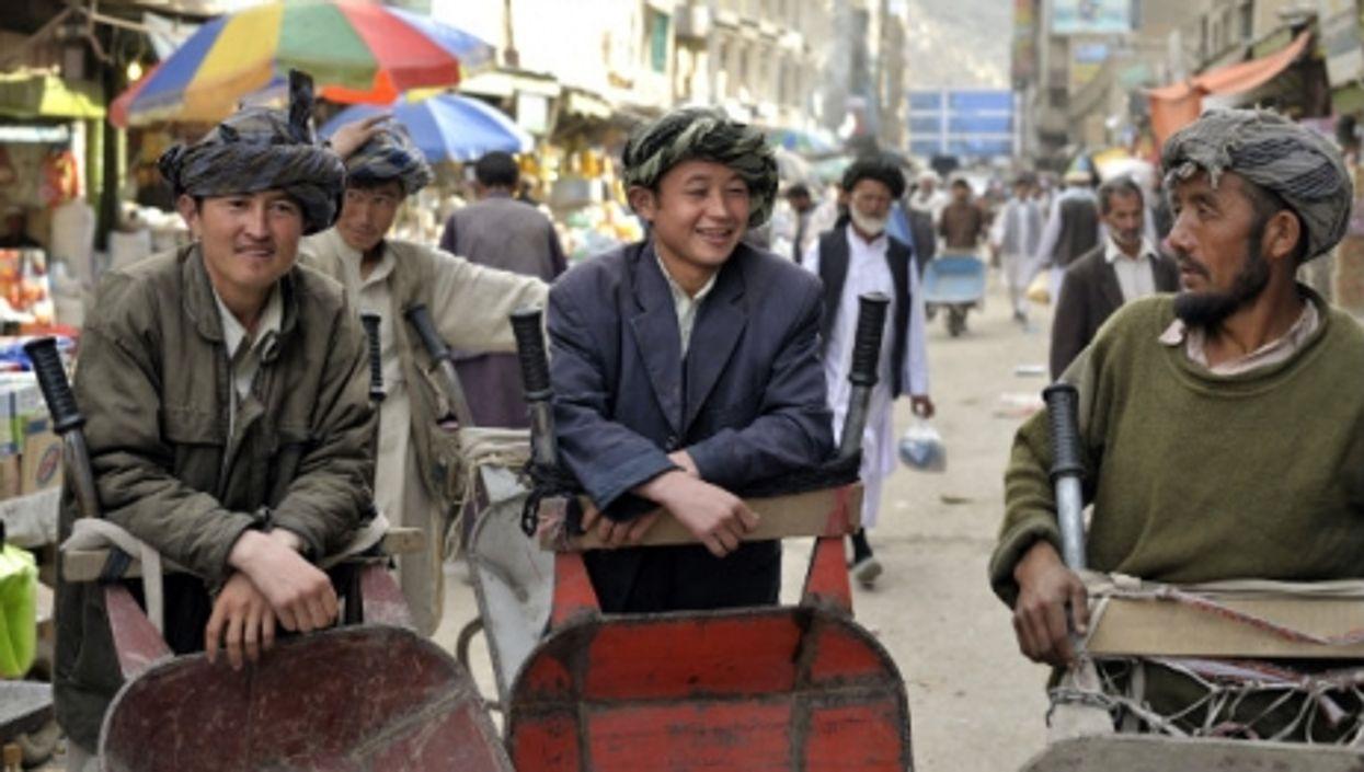 Hazara men at Kabul's Pashtun Bazaar.