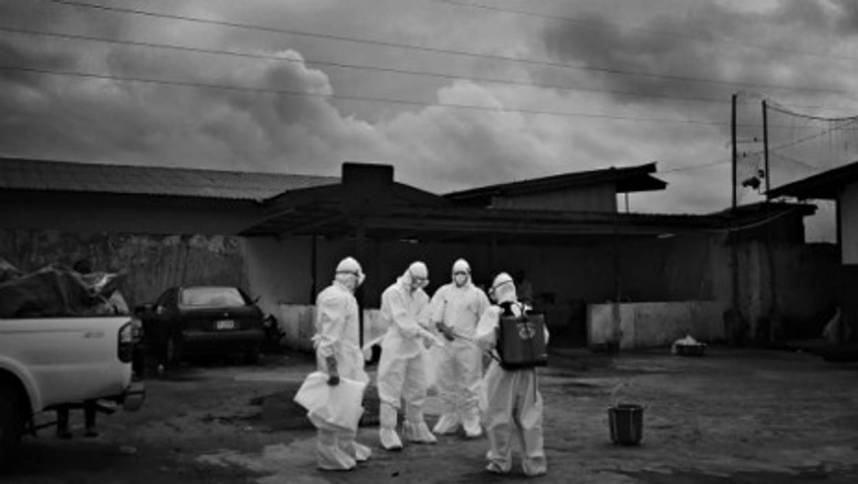 Hazmat-suited workers fighting Ebola in Unification Town, Liberia on Aug. 30