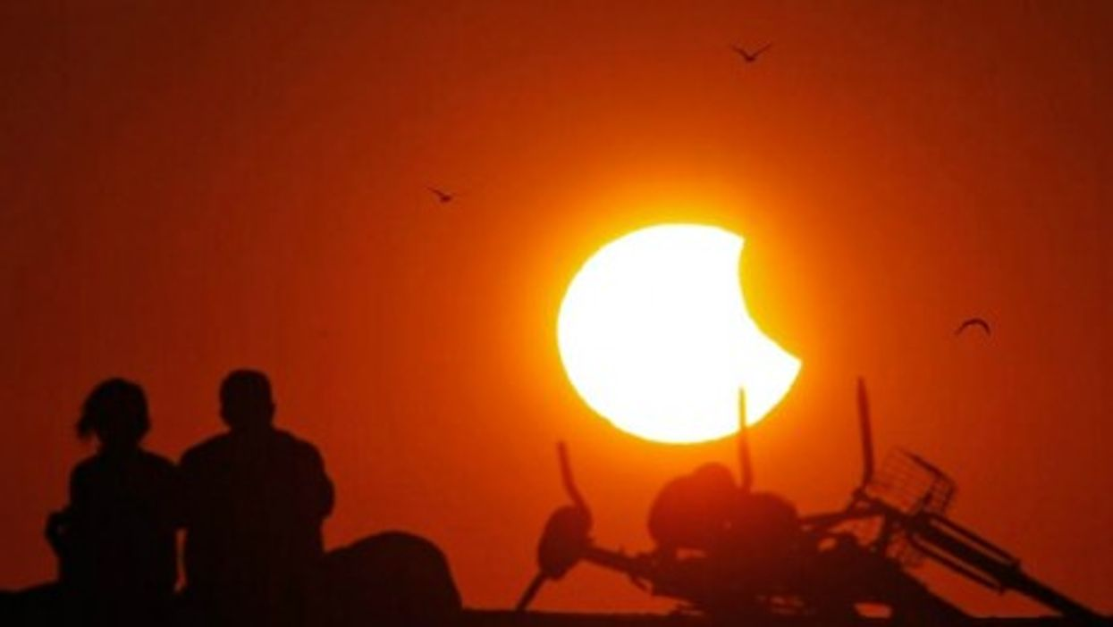 he sun sets over the Gulf of Mexico Thursday, during a partial solar eclipse.