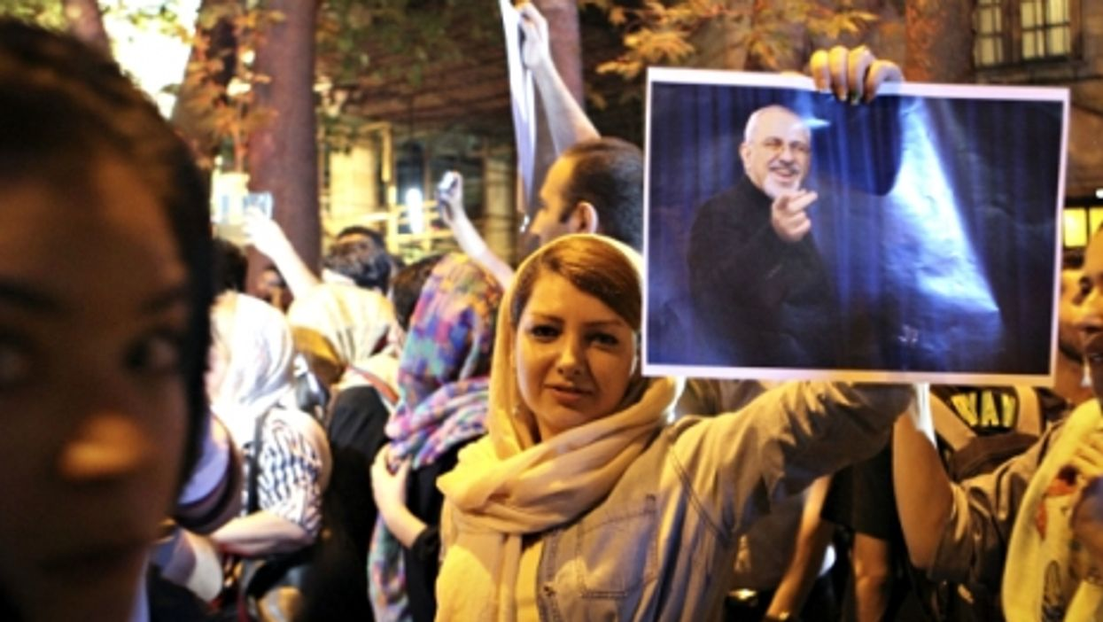 Holding a poster of Iranian Foreign Minister Mohammad-Javad Zarif to celebrate the nuclear agreement, in Tehran on July 14