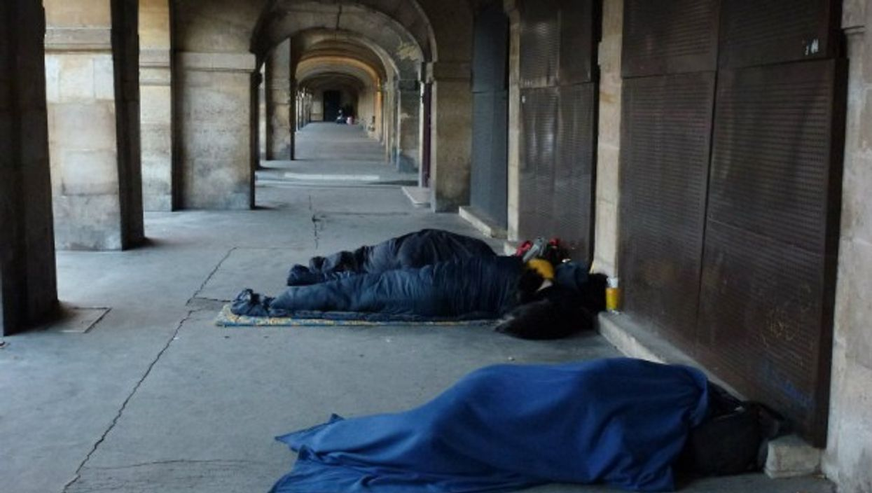 Homeless people sleeping near Places des Vosges in Paris