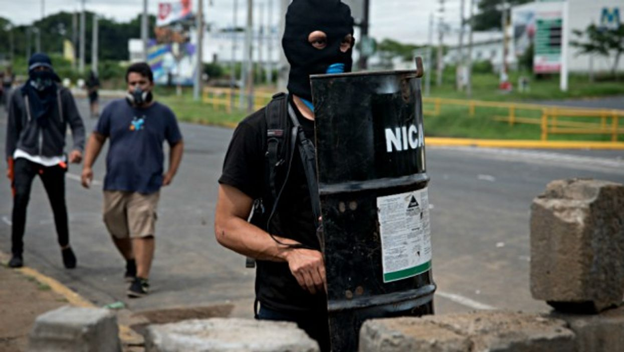 Hooded students Managua, Nicaragua guard their university from Ortega's paramilitaries who storm campuses and injure dozens