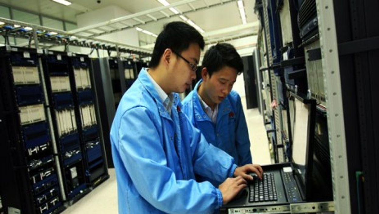 Huawei staff performing routine maintenance