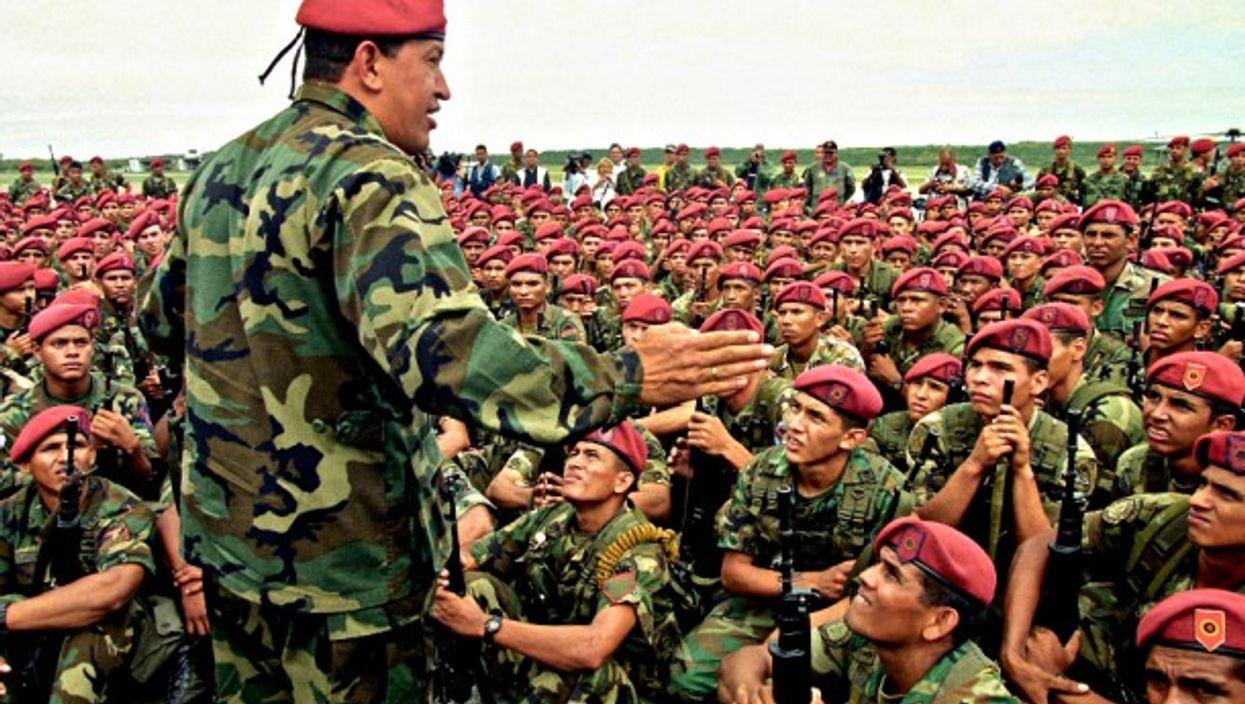 Hugo Chavez talking to soldiers in Vargas in 1999