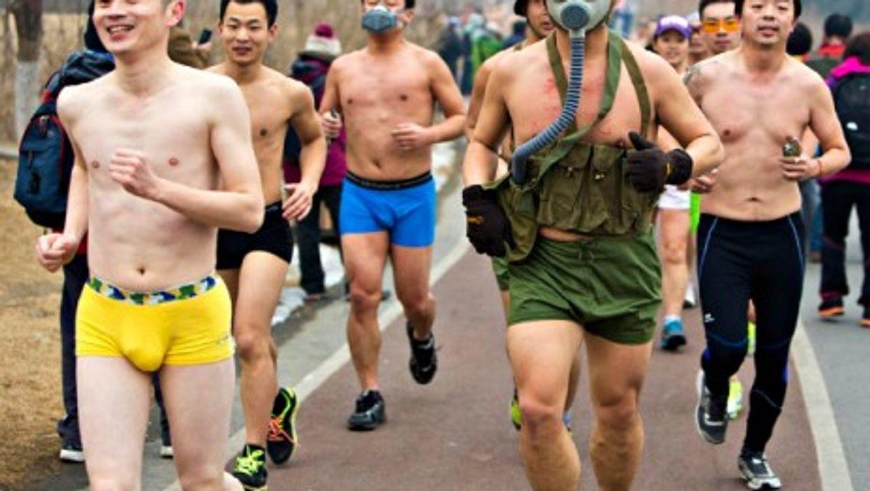 Hundreds of joggers ran semi-naked in Beijing's smog