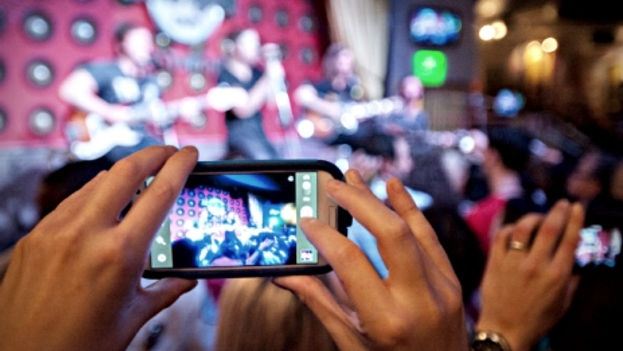 Hundreds of potential concert photographers