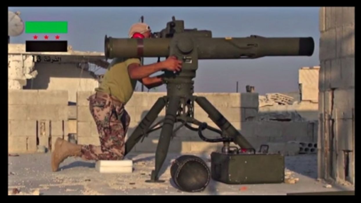 Image provide by FSA of its fighter firing BGM-71 Tow missile in Homs, Syria