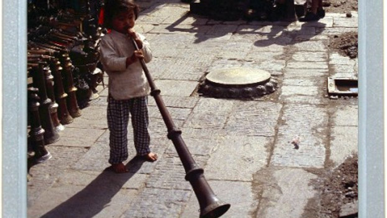 Small Tibetan Boy, Big Tibetan Trumpet
