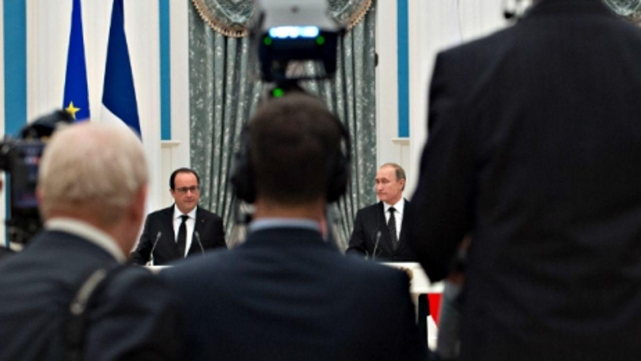 Kremlin Keeps Distance, France Honors Victims, Black Friday Advice