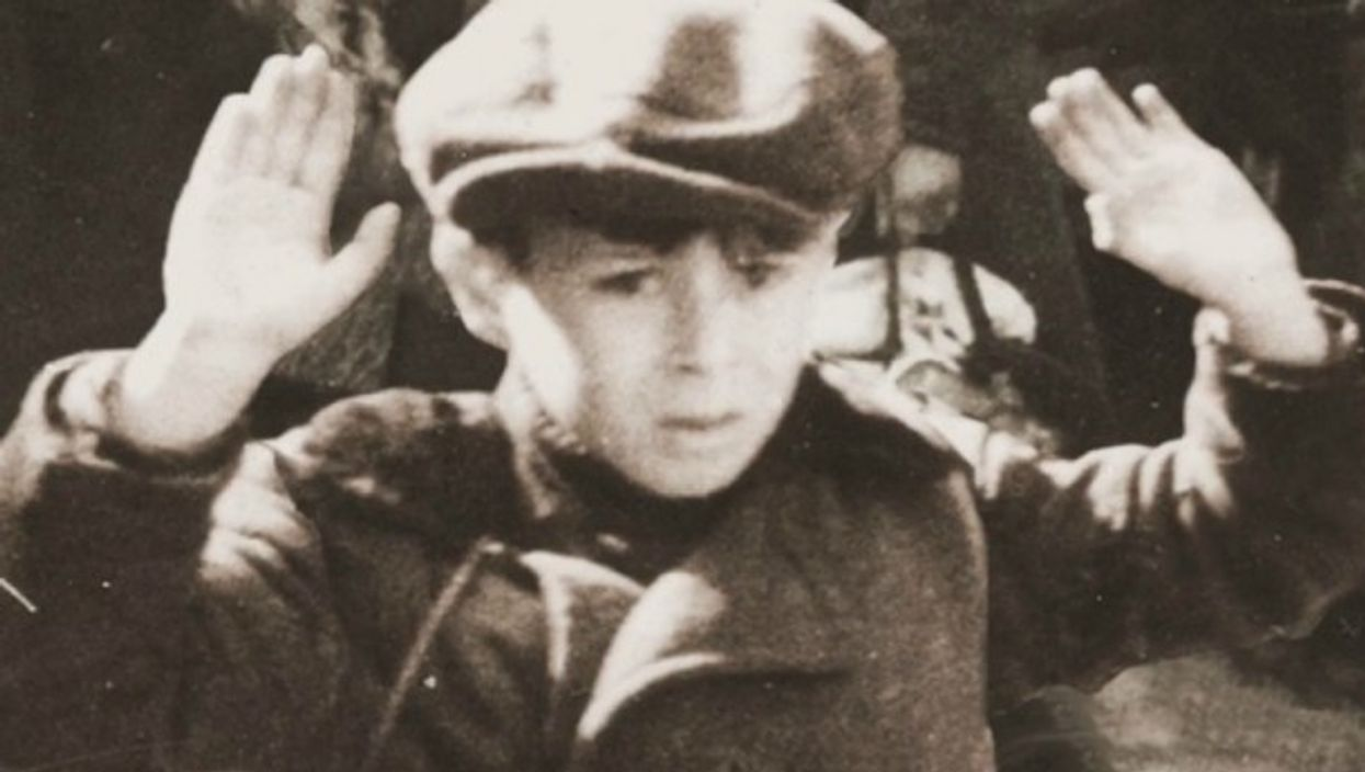 Watch: The Story BehindIconic Holocaust Photo Of Warsaw Child