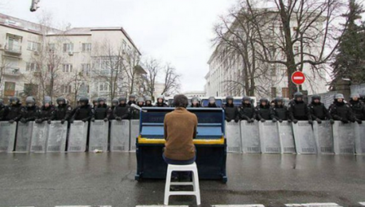 Snapshot Of The World: Kiev Protests, Mourning Mandela, Holy Snow