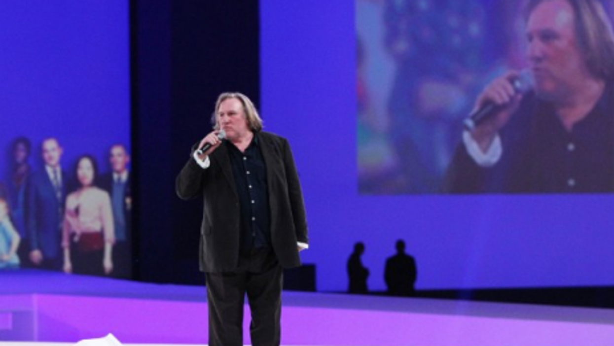 Thai PM out, S. Africa vote, Depardieu's drinking