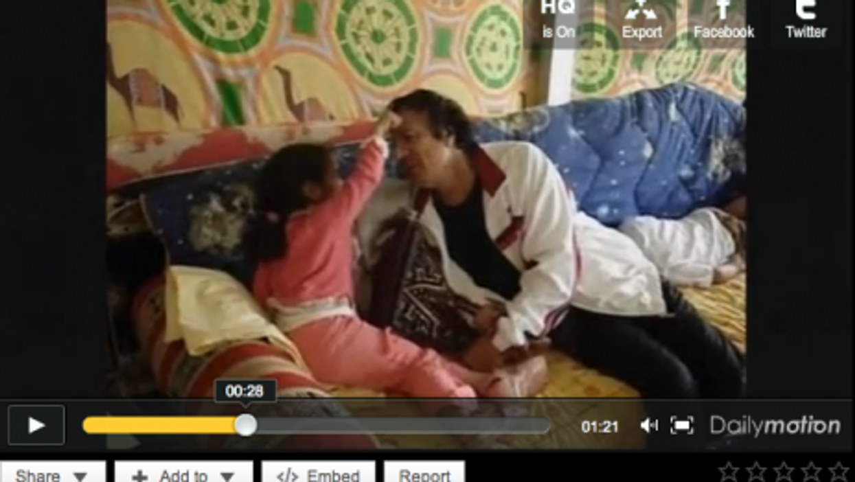 Exclusive: Grandpa Gaddafi? Home Video Shows Dictator's 'Playful' Side