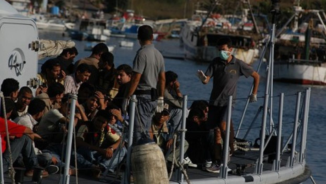 Immigrants in the port of Lampedusa