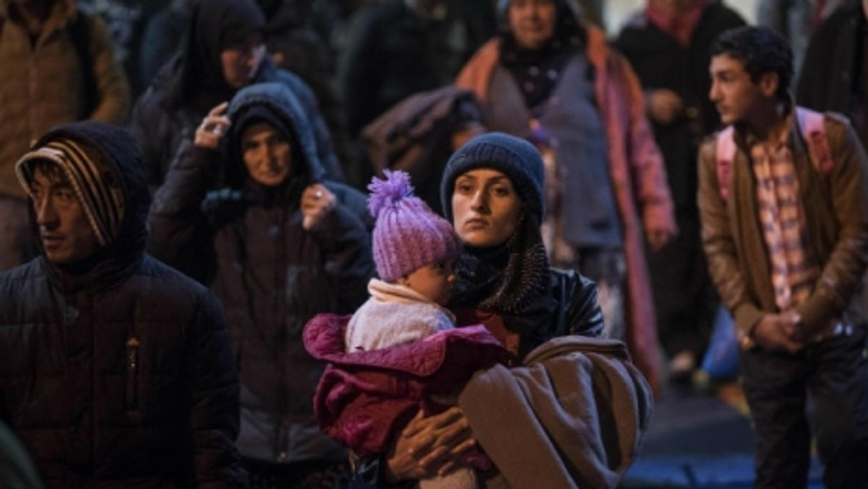 Immigrants who crossed over from Turkey arrive in Greece